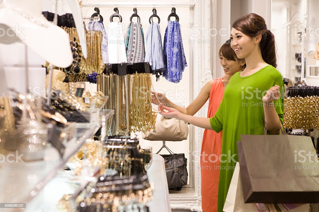 Two women are shopping in the store stock photo