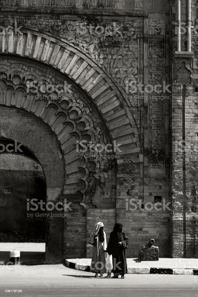 Two Women at Marrakesh Gate: Bab Agnaou stock photo