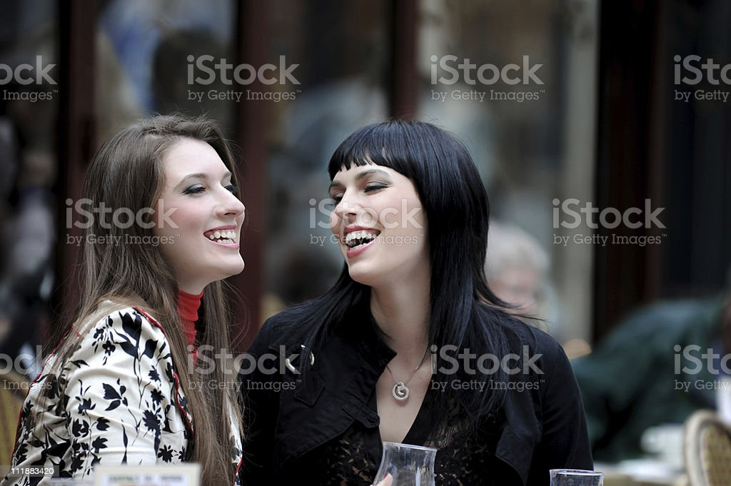 Two Women Best Friends at Sidewalk Cafe Paris France royalty-free stock photo