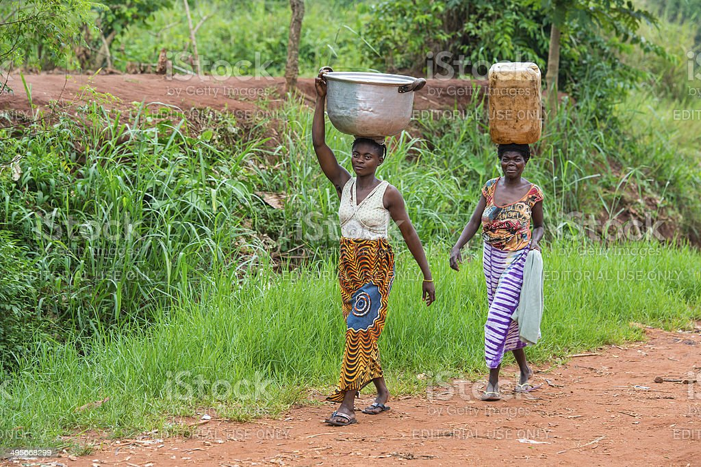 Two women carrying goods on their heads, DR Congo stock photo