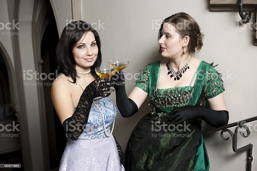 Two women cheering at a cocktail party royalty-free stock photo