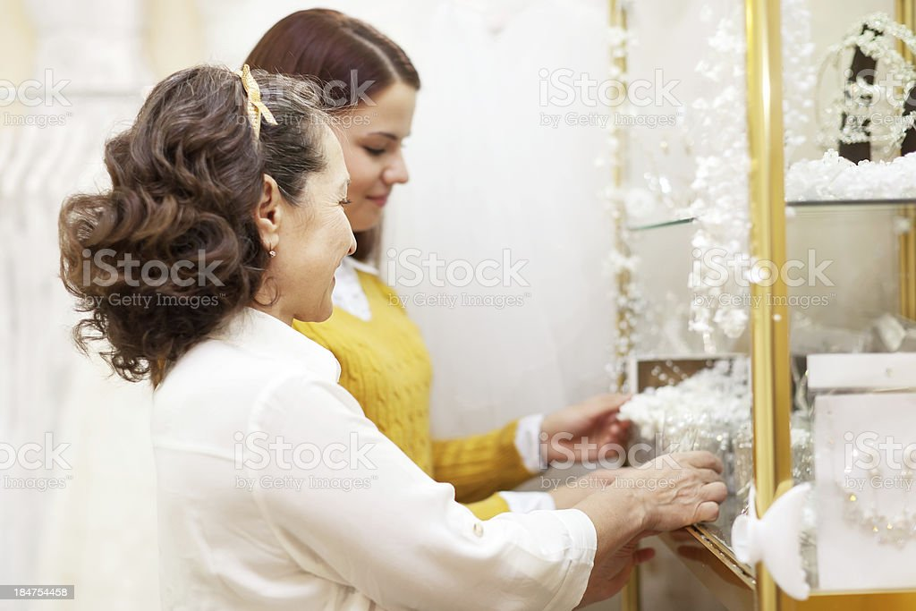 Two women  chooses bridal accessorie royalty-free stock photo
