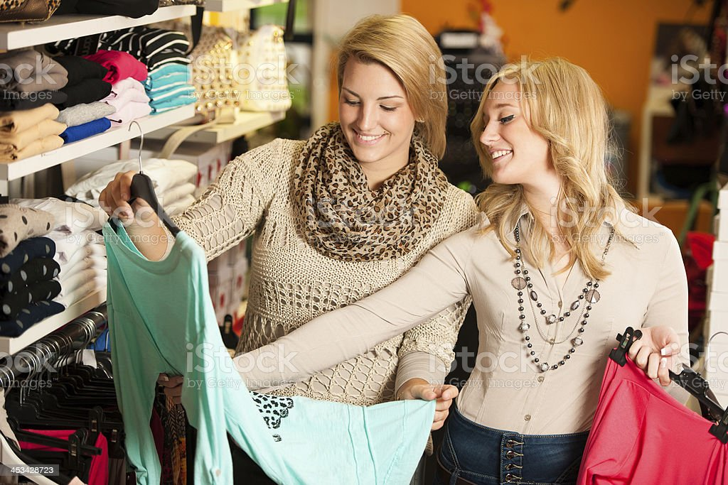 Two women clothes shopping together stock photo