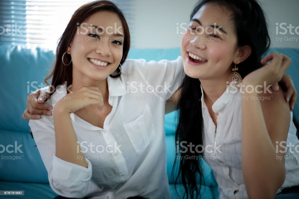 two women Competitive friends excited happy cheerful and smiling at home stock photo