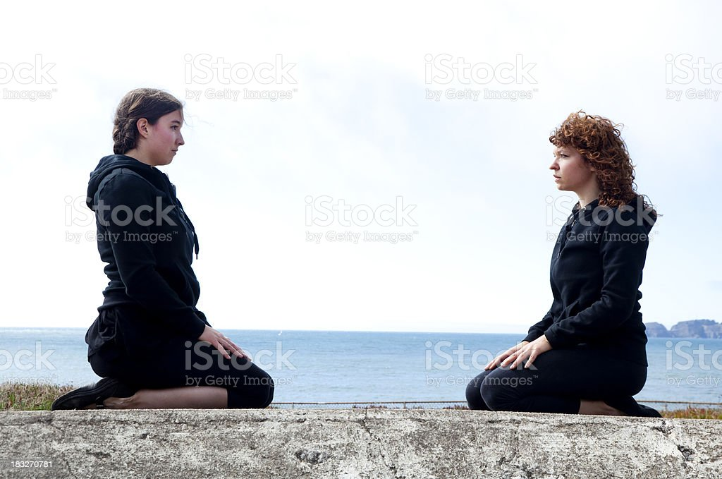 two women confronting each other stock photo