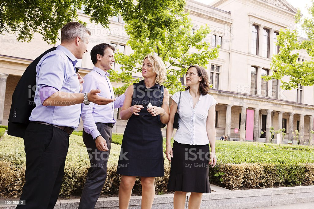 Two Women Couple of Men Discussing in Garden royalty-free stock photo