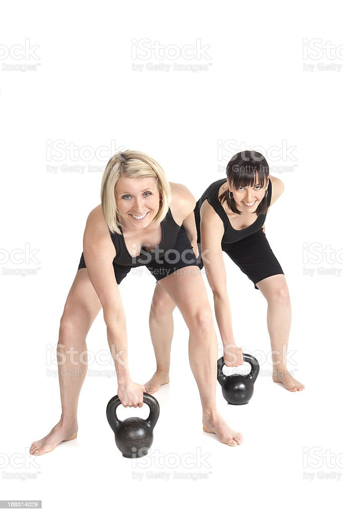 Two Women Doing Kettle Bells royalty-free stock photo