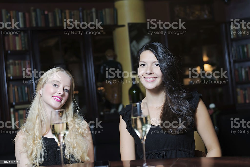 Two women drinking at an upmarket hotel royalty-free stock photo
