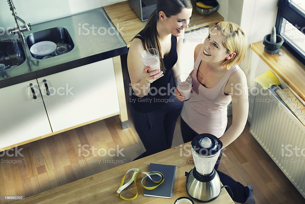 Two Women Enjoying a Meal Replacement Shakes stock photo