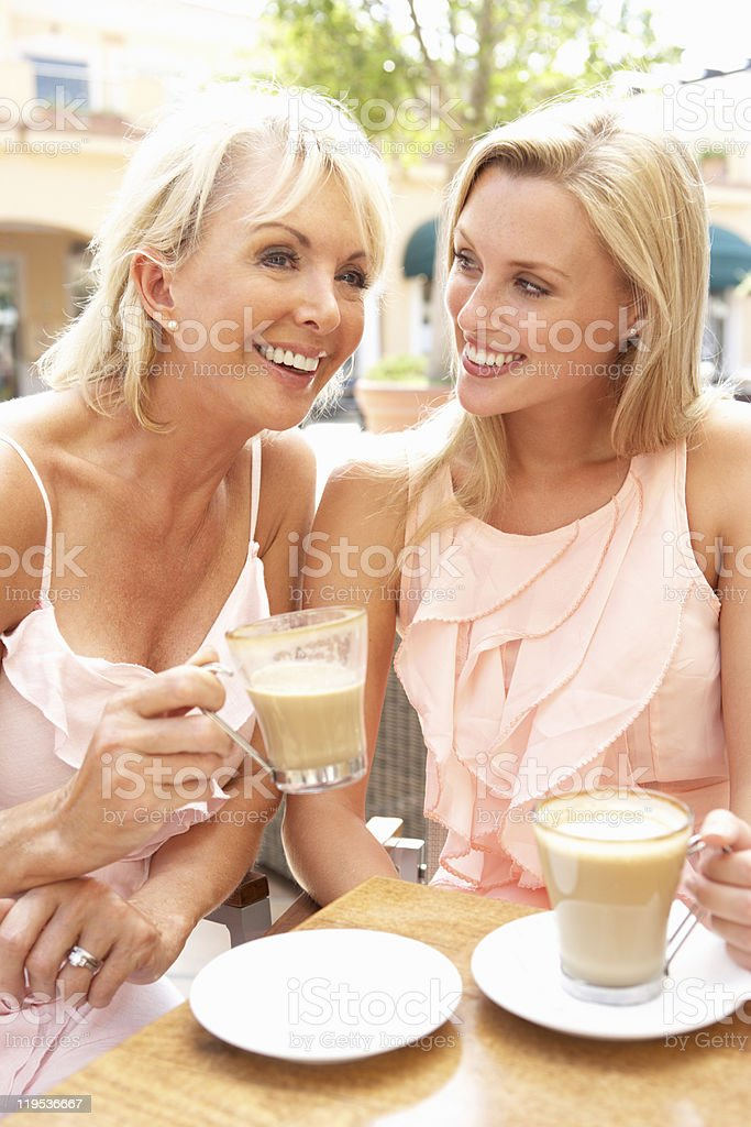 Two Women Enjoying Cup Of Coffee In Café royalty-free stock photo
