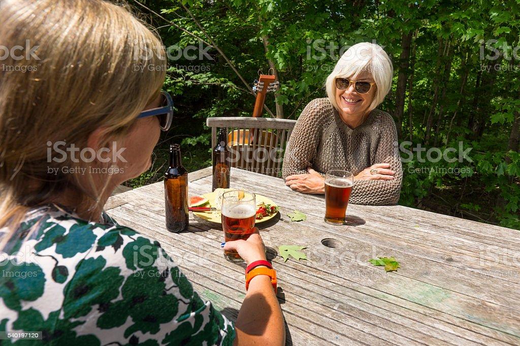 Two women enjoying some craft beer. stock photo