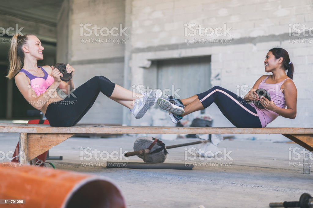 Two women exercising in an urban gym stock photo