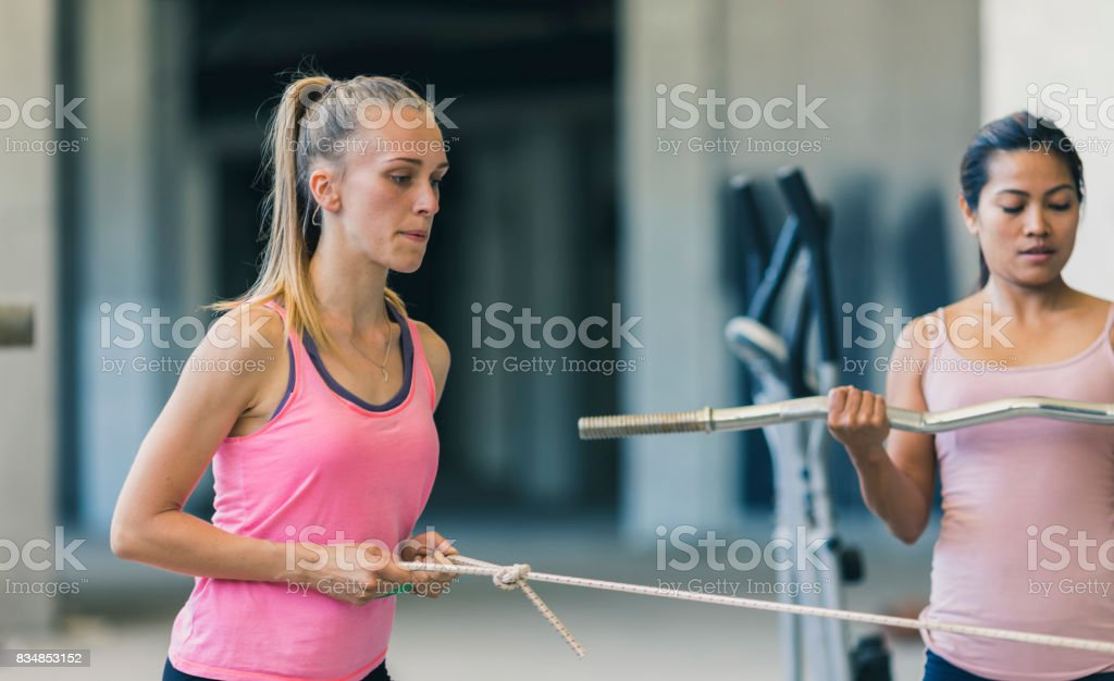 Two women exercising in an urban gym stock photo