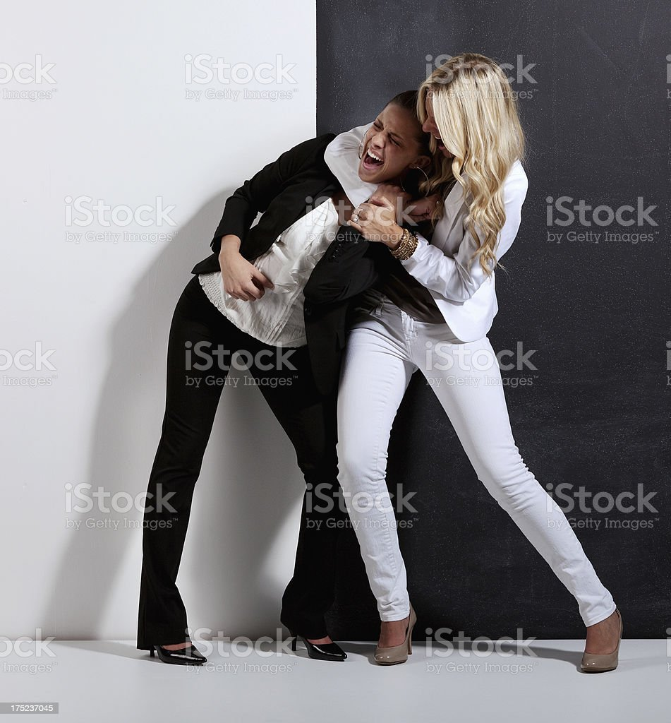 Two women fighting stock photo