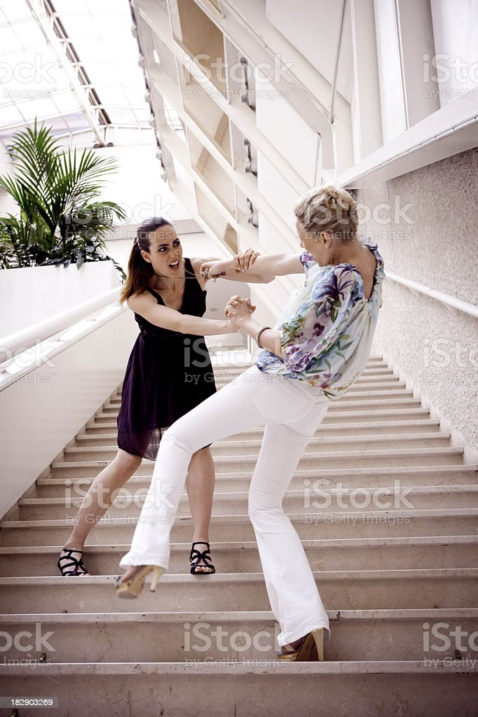 Two women fighting royalty-free stock photo