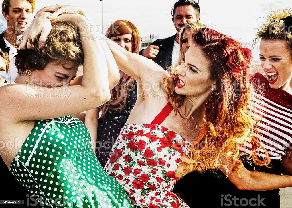 Two women fighting. stock photo