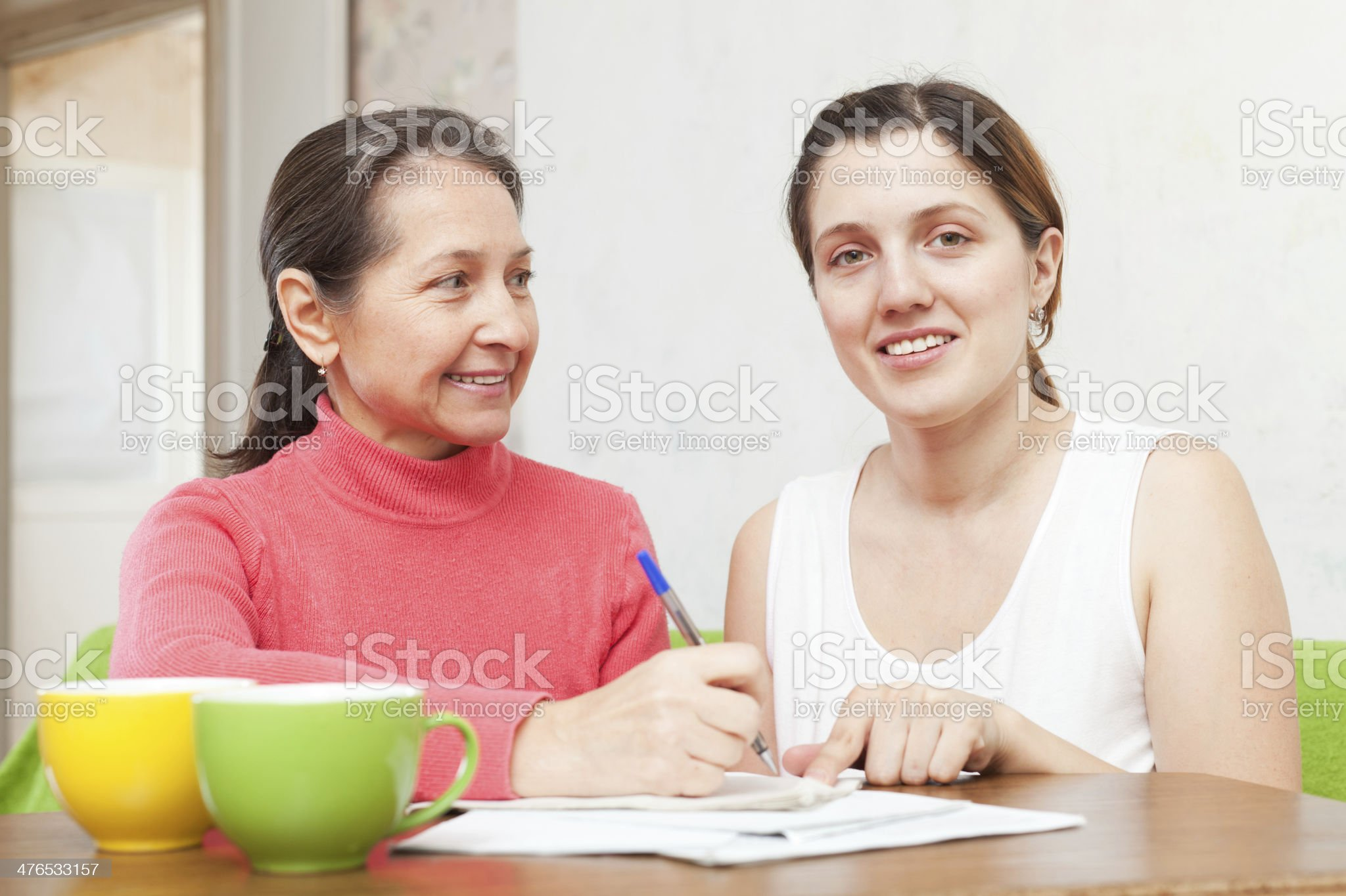 Two women fills in the questionnaire royalty-free stock photo