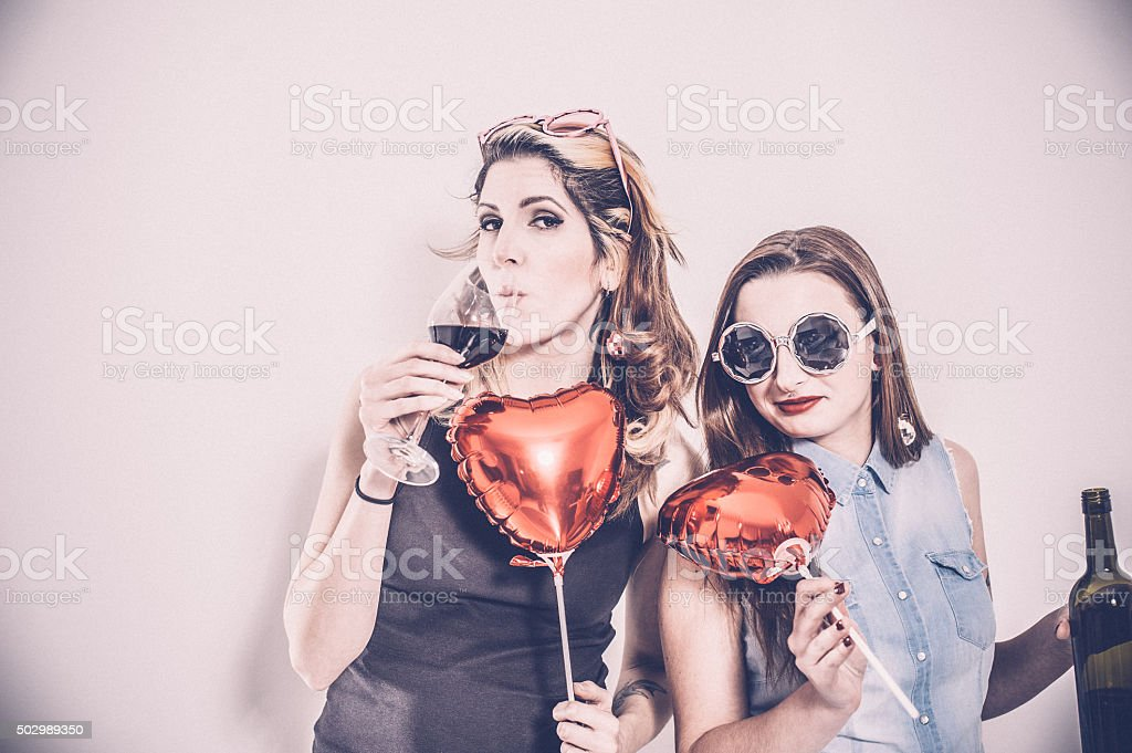 Two Women Friends Drinking Red Wine Together stock photo