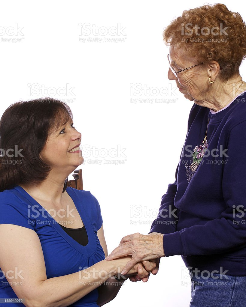 Two women greeting one another royalty-free stock photo