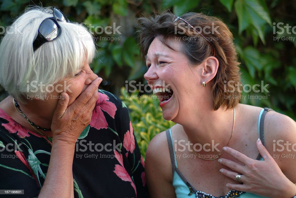 Two women having fun and laughing stock photo
