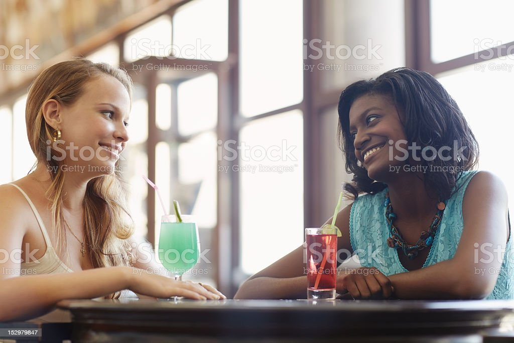 two women having fun in pub royalty-free stock photo