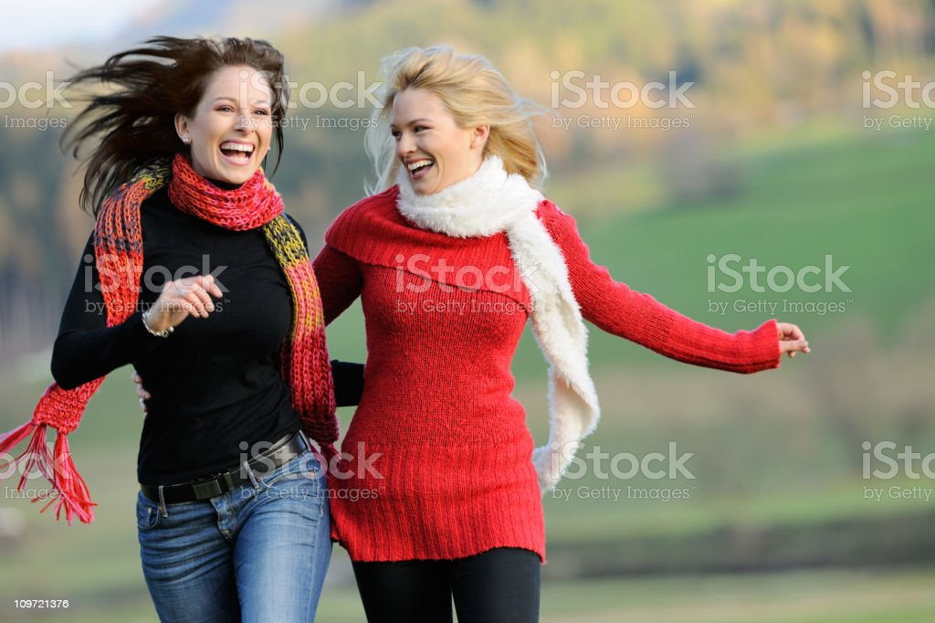 Two Women having Fun Outdoor (XXXL) royalty-free stock photo