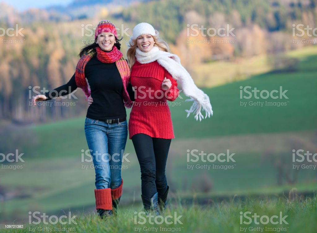 Two Women having Fun Outdoors royalty-free stock photo