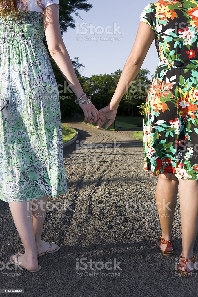 Two women holding hands royalty-free stock photo