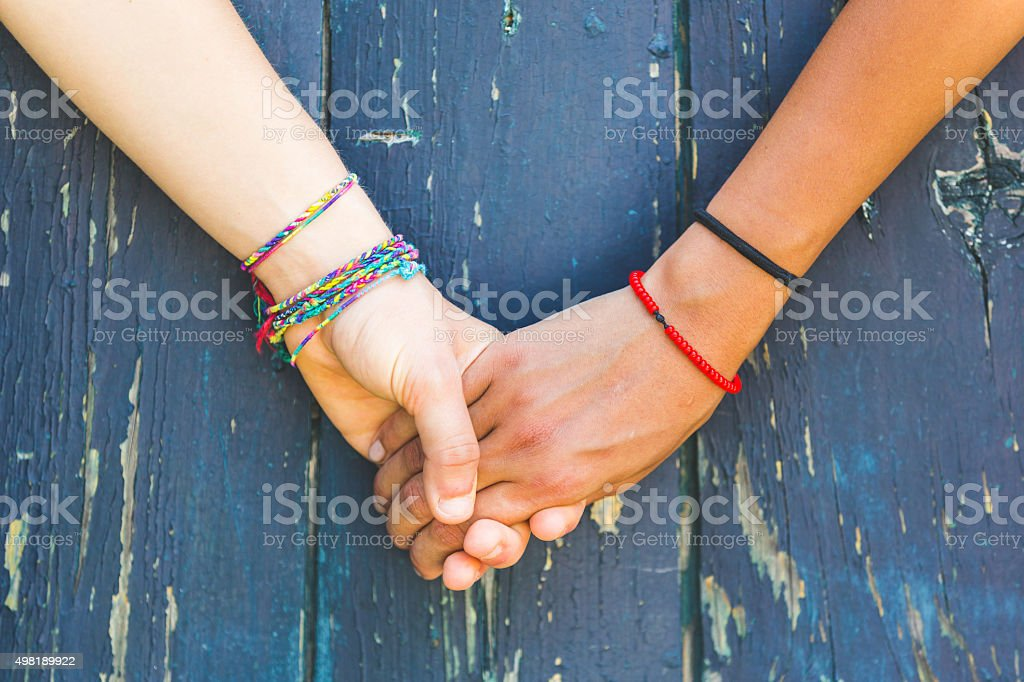 Two women holding hands stock photo