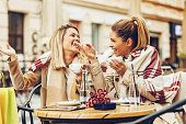 Two women in cafe after shopping