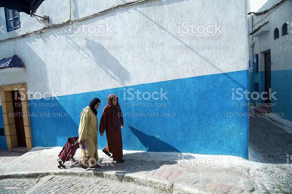 Two Women in Kasbah des Oudaias, Rabat, Morocco stock photo