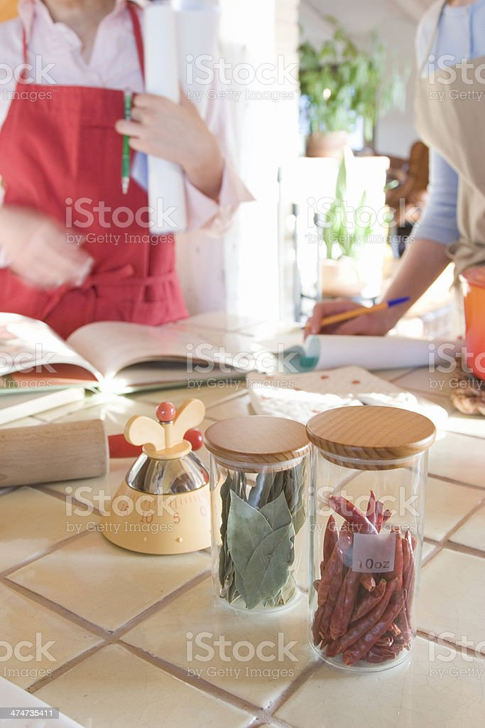 Two women in kitchen stock photo