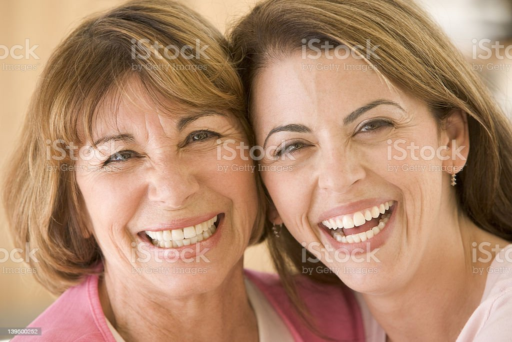 Two women in living room smiling royalty-free stock photo