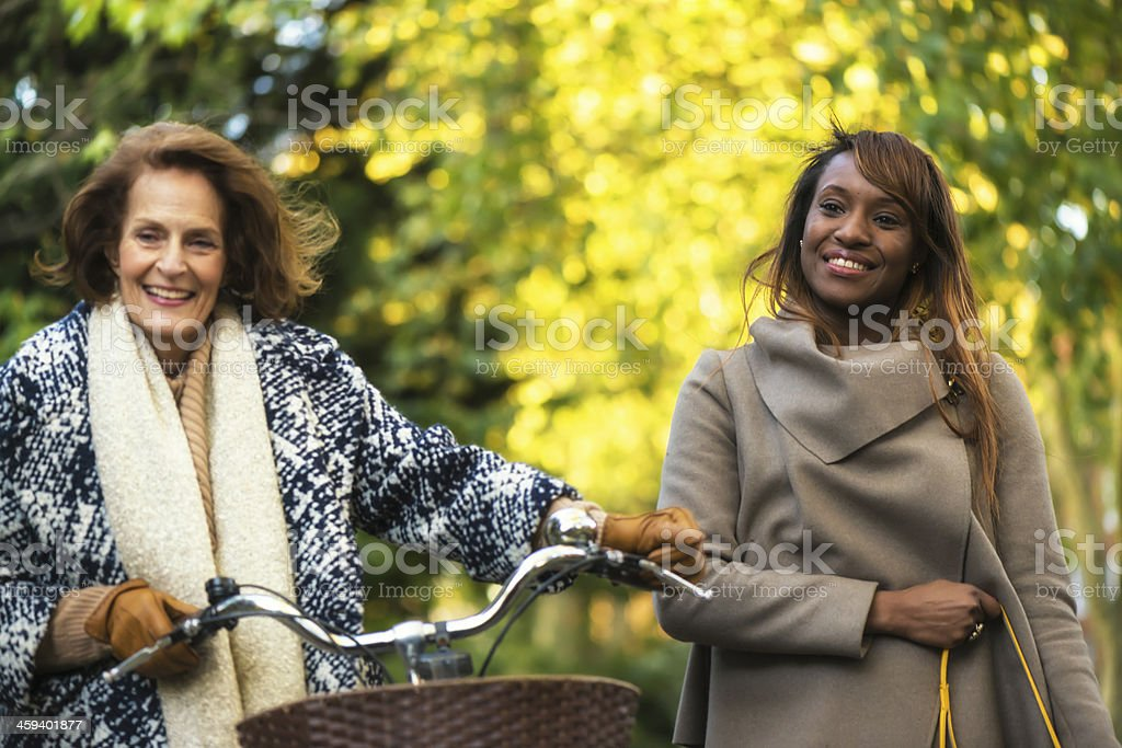 Two women in park royalty-free stock photo