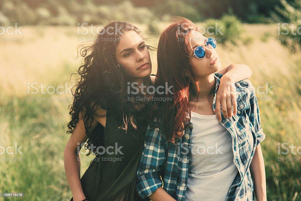 Two women in the fields stock photo
