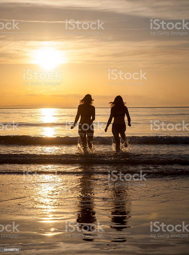 two women in the midnight sun,lofoten,norway stock photo