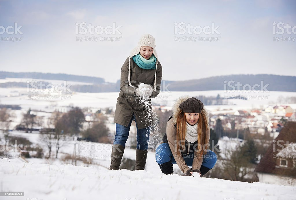 Two women in the snow royalty-free stock photo