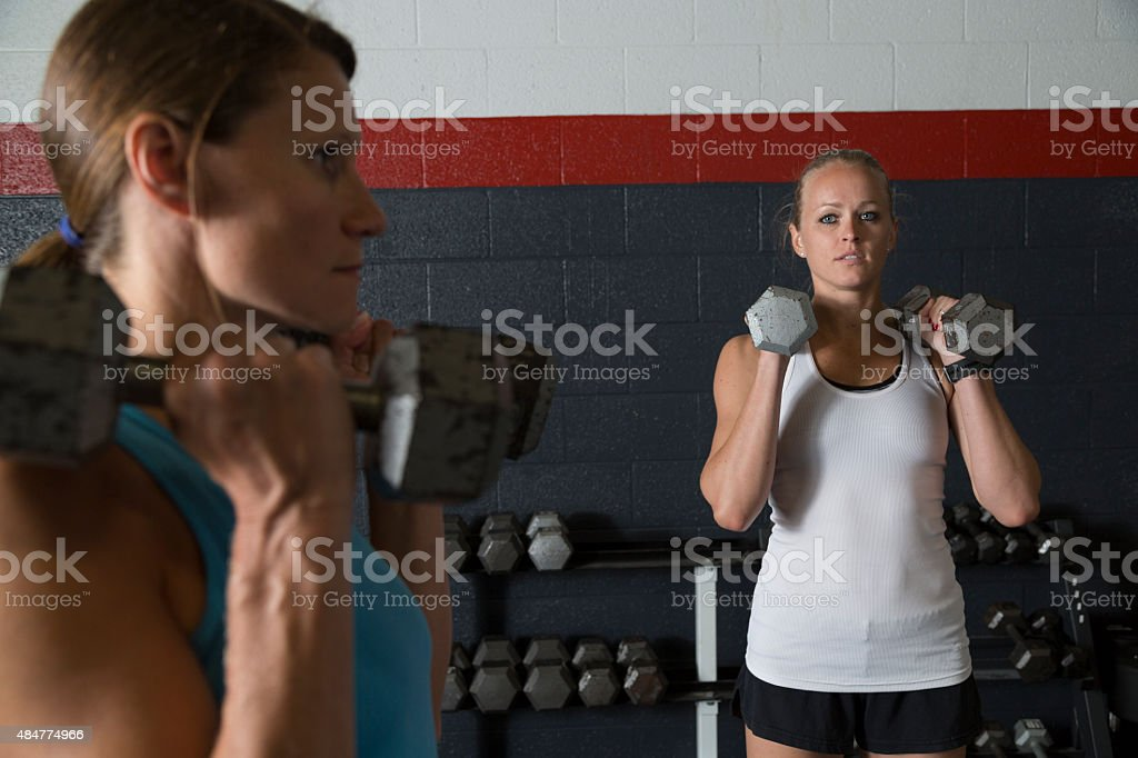Two Women Lifting Weights stock photo