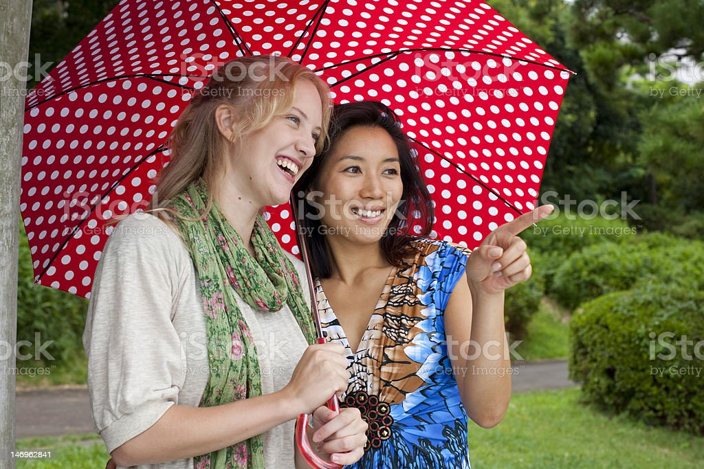 Two women looking and smiling royalty-free stock photo