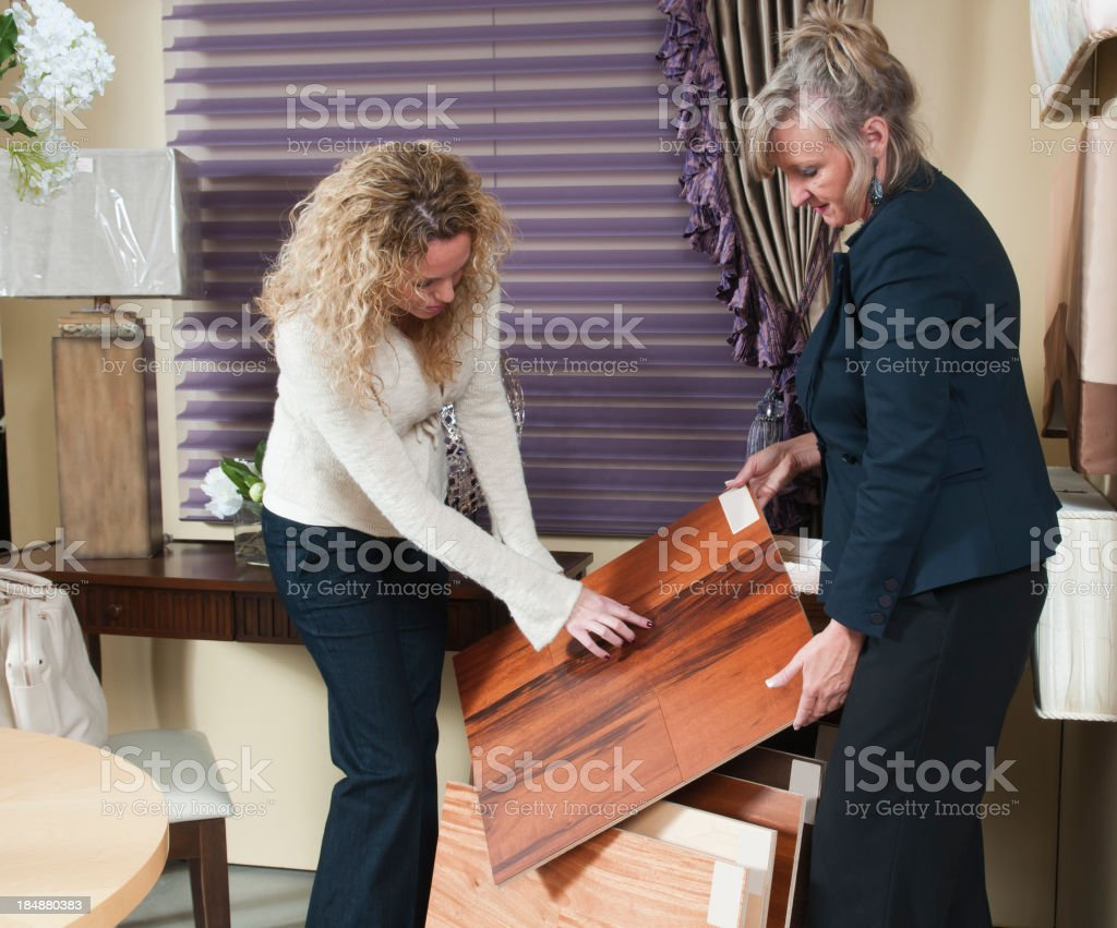 Two Women Looking At Flooring Samples royalty-free stock photo
