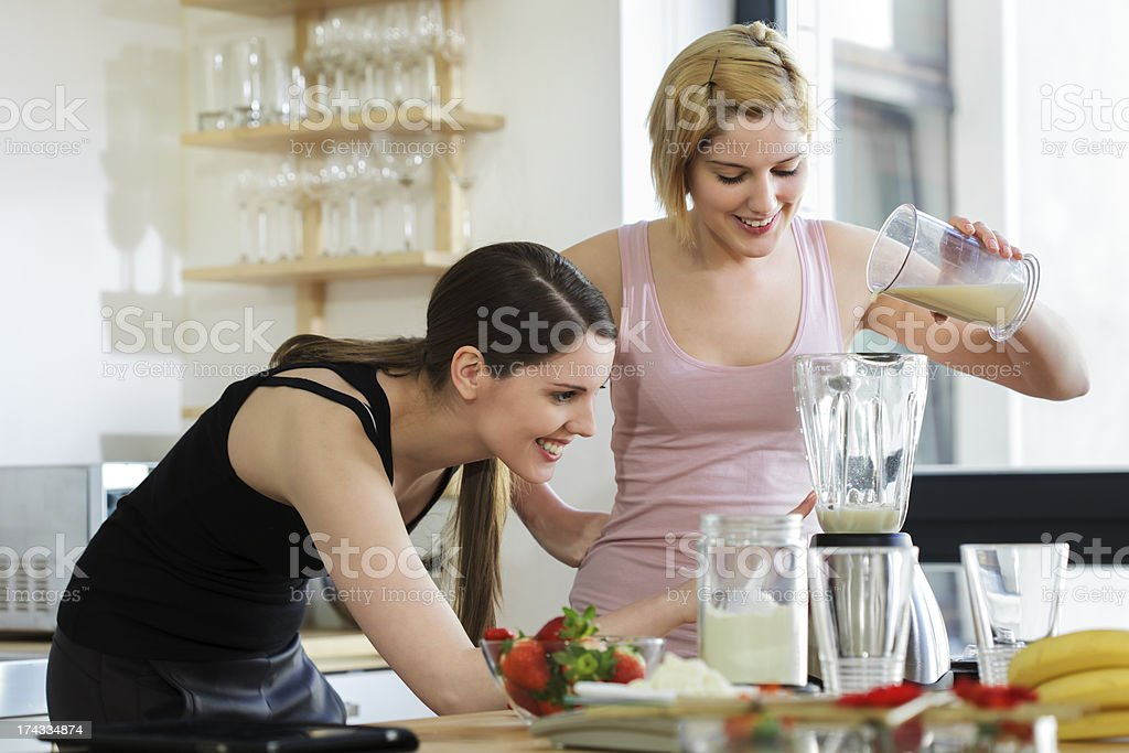 Two Women Making a Meal Replacement Shakes stock photo