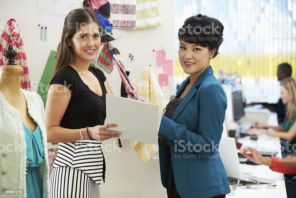 Two Women Meeting In Fashion Design Studio royalty-free stock photo