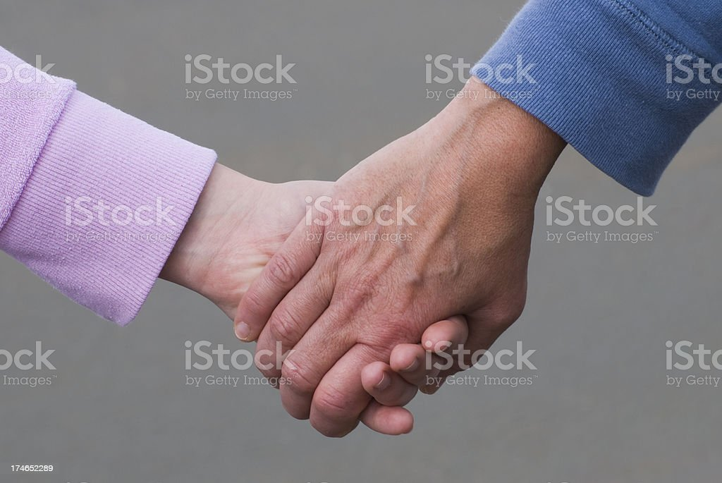 Two women, mother and daughter holding hands royalty-free stock photo