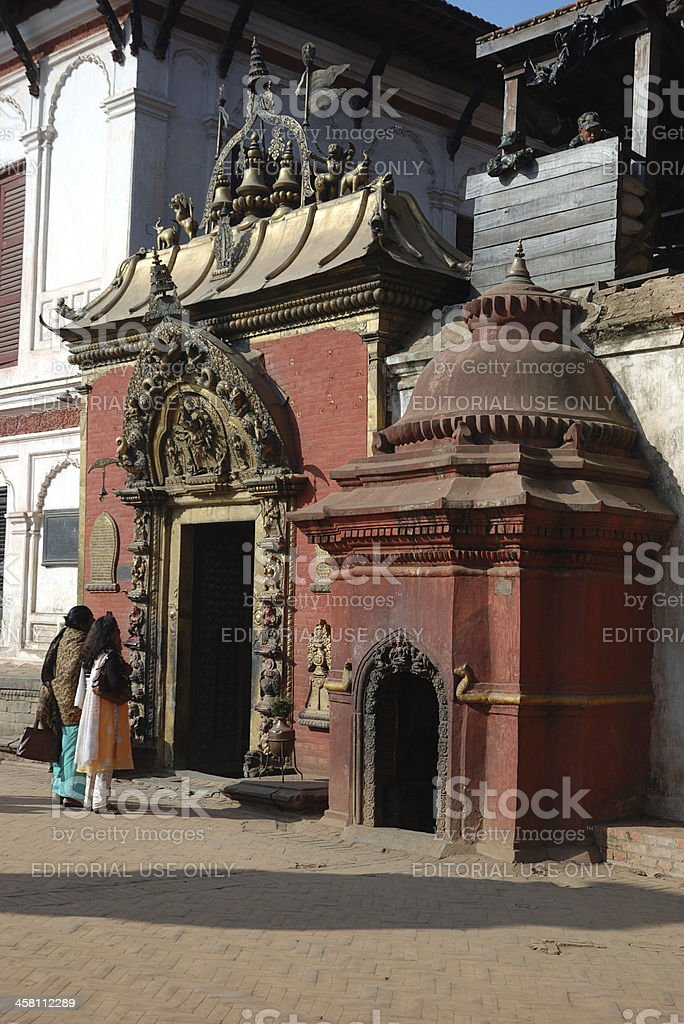 Two women near hindu temple ,Bhaktapur,Nepal royalty-free stock photo