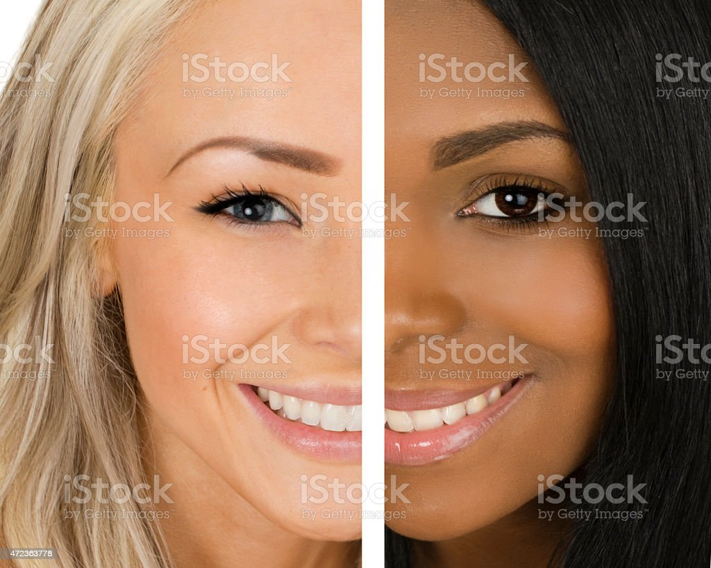 two women of different race stock photo