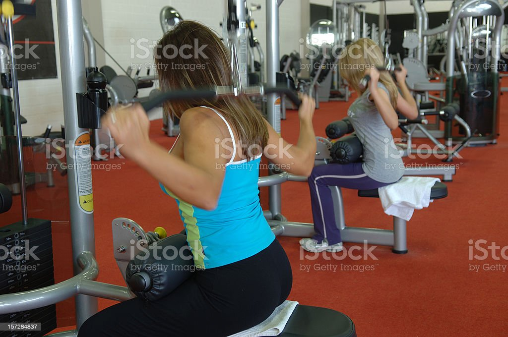 Two women on a lat machine royalty-free stock photo