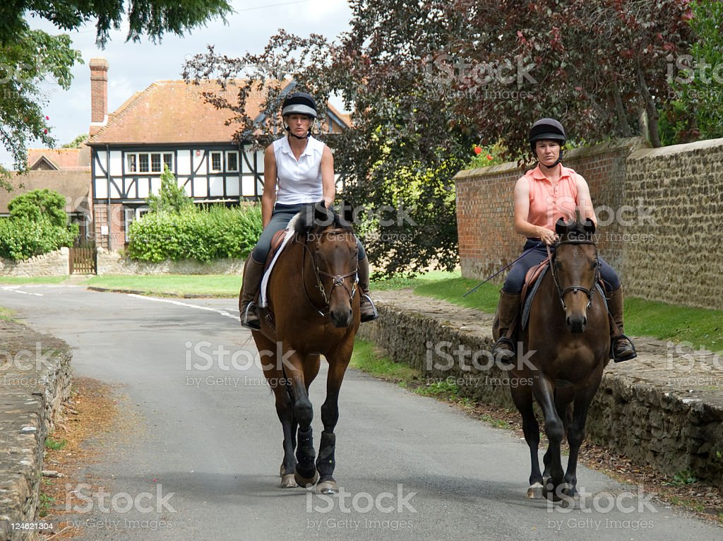 Two Women on horses hacking out stock photo
