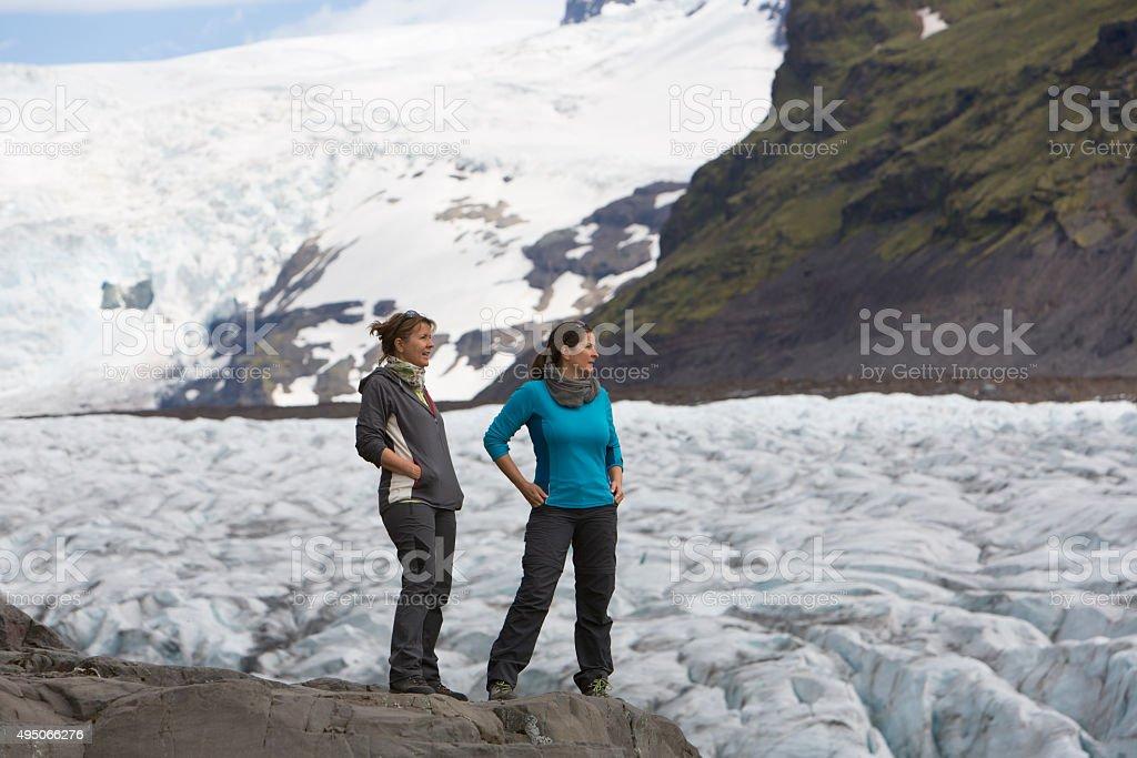 two women on the glacier vatnajökull,Iceland stock photo
