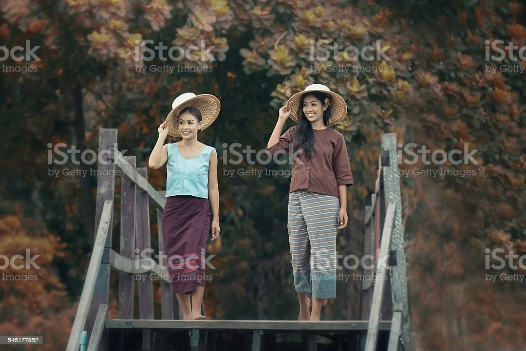 Two women outside in relationship stock photo