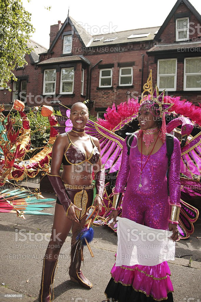 Two women performers waiting for Leeds Carnival parade royalty-free stock photo